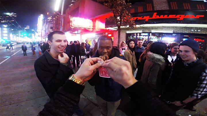 Vancouver Hypnotist Hadlen performing a magician feat on the granville street